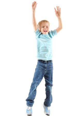 白い背景の上陽気なジャンプ 5 歳の少年 写真素材