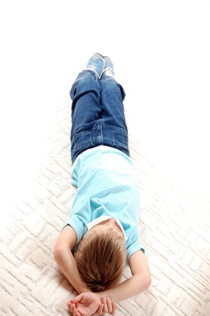little boy lying on the floor with mask photo