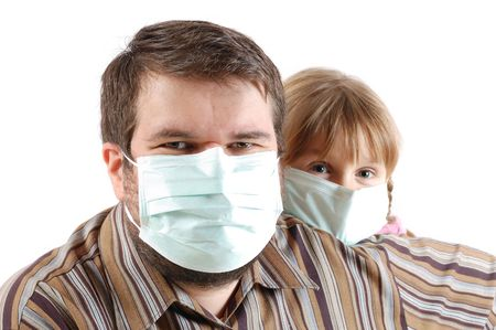 man and a little girl wearing surgical protactive face masks photo