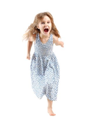 haste: adorable caucasian 5 year old girl running and screaming over white
