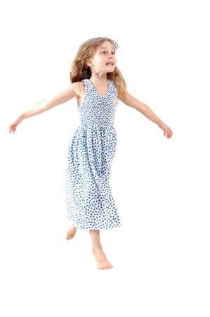 little girl dancing: Adorable caucasian 5 year old girl dancing. Isolated Stock Photo