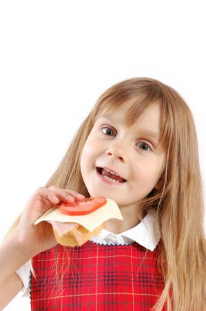 caucasian 5 year old girl eating a sandwich photo