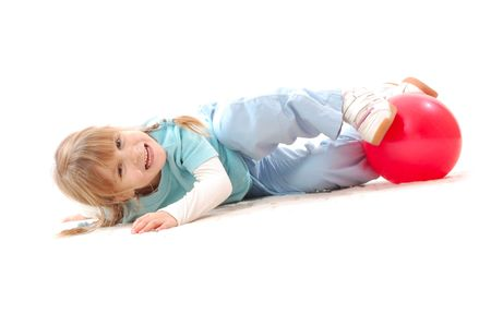 cheerful  5 year old girl with a red ball over white