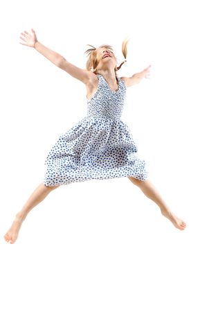 5 year old girl flying with her hands like wings photo