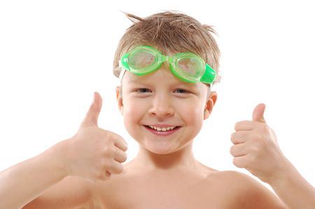 smiling elementary 5 year ols  boy with wet hair,  goggles and thumbs up over white photo