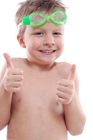 happy 5 year old boy with goggles and thumbs up