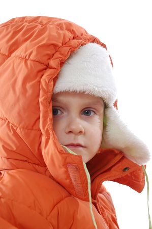 little girl in an orange coat and a flapped fur hat and hood photo