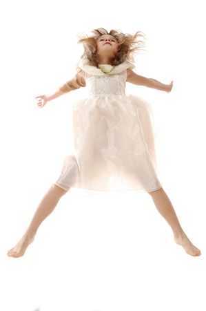 adorable caucasian 5 year old girl jumping high up Stock Photo - 6104730