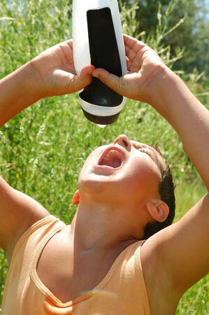 outdoor portrait of a teenage boy on a hot summer day drinking water from a sportive bottle Stock Photo - 6104802