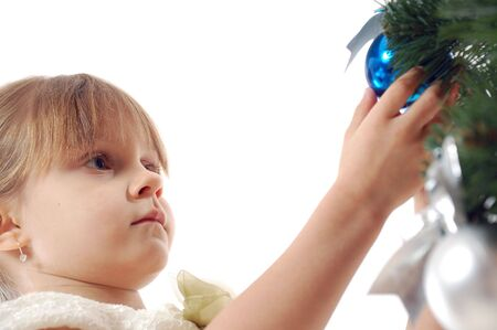 little girl decorating a Christmas tree with a ball Stock Photo - 6104778