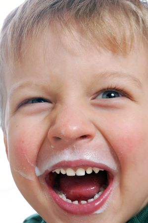 shouting boy with hice face covered with milk Banco de Imagens
