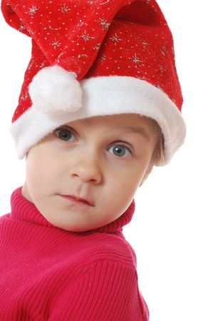 cute littel  girl wearing a Santa Clause hat photo