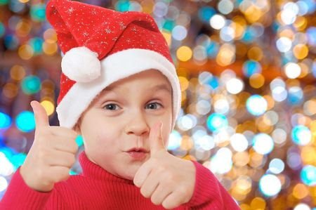 elf's: little happy girl wearing a Santa Clause hat Stock Photo