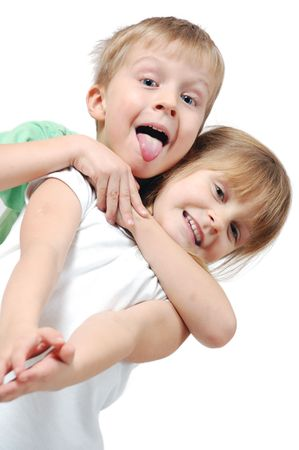 happy 5 year old girl and boy over white background photo