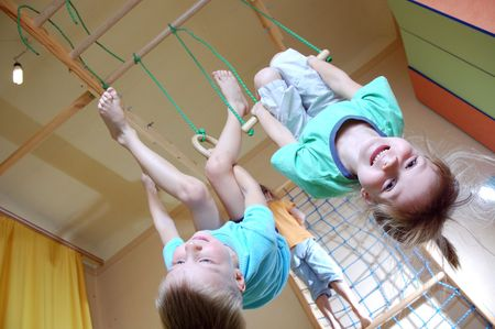 strong boy:  5 year old children playing with home sport gym  Stock Photo