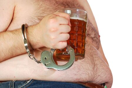 obese man's hand chained with cuffs to a mug of beer Stock Photo - 6568630