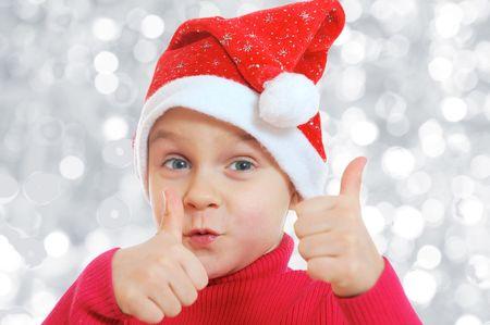 幸せなクリスマスの子供を thumds と 写真素材