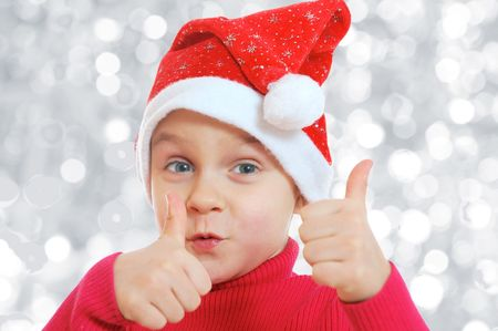happy Christmas child with thumds up photo