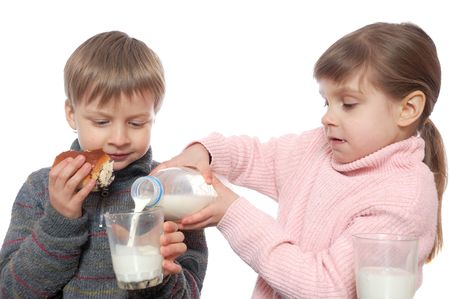 each: two children having lunch with milk and doughnuts
