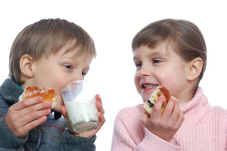 two 5 year old kids eating and drinking milk Stock Photo - 6631550