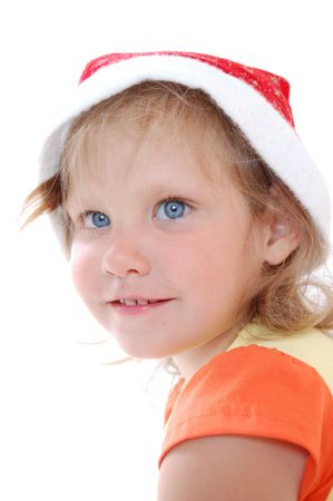 Beautiful little girl with blue eyes wearing hat. photo