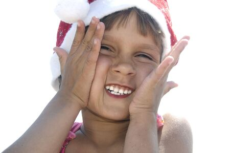 little happy girl with a Santa hat photo