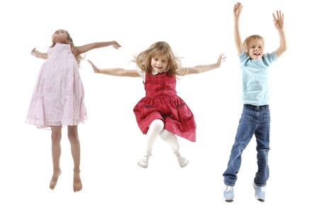 moving activity: group of 5 year old happy children jumping over white