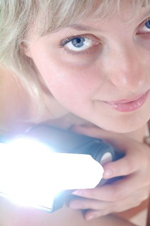 portrait of a young beautiful blond Caucasian woman with a flash photo