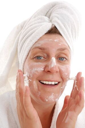 portrait of a middle-aged blue-eyed woman with cream on her face photo