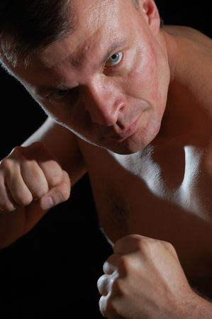 close-up studio portrait of a middle-aged aggressive  man ready for boxing Stock Photo - 7866540