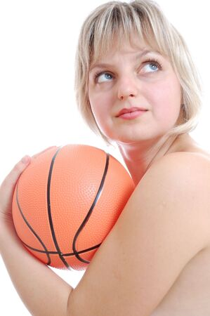 saxy: portrait of a young beautiful blond Caucasian woman with a basketball ball