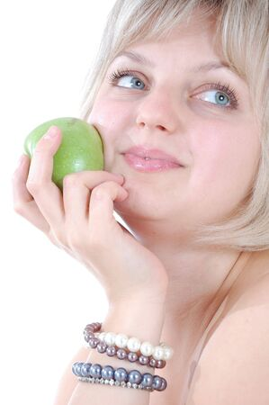 saxy: portrait of a young beautiful blond Caucasian woman lwith a green apple