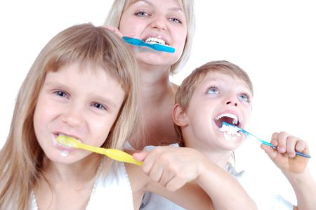 three people  cleaning  teeth over white background photo