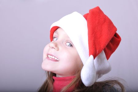 little happy girl wearing a Santa Clause hat Stock Photo - 8184881