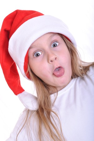 little surprised girl wearing a Santa Clause hat photo