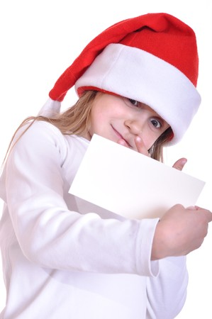 little surprised girl wearing a Santa Claus hat and holding a white banner Stock Photo - 8165897