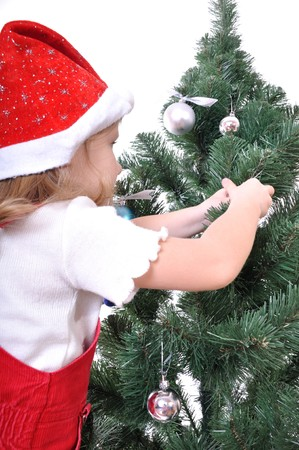 solo  christmas: little girl decorating Christmas  Tree. Isolated over white