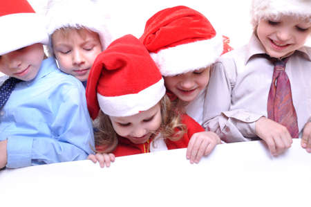 group of happy kids with Santa hats with a banner photo