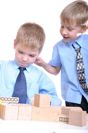 portrait of 6-7year old boys playing with wooden bricks Stock Photo - 8165920