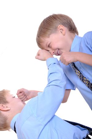 Two schoolboys fighting. Isolated over white. Stock Photo - 8165915