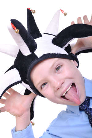 buffoon: portrait of 7 year old boy wearing a funny clown hat Stock Photo