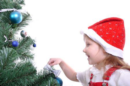 Happy smiling kid in Christmas costume preparing the Christmas tree photo