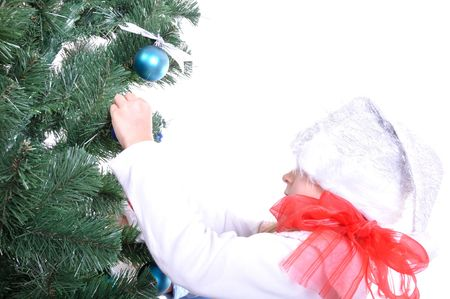 Happy smiling kid in Christmas costume preparing the Christmas tree Stock Photo - 8177293