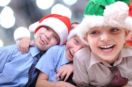 group of happy kids with Santa hats photo