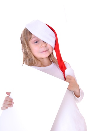 little girl wearing a Santa Clause hat holding a banner photo