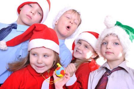 group of five elemetary age happy kids with Santa hats Stock Photo - 8317681