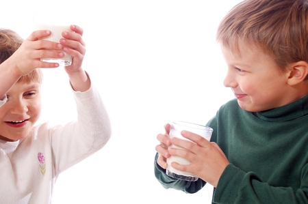 kids drinking milk from glasses together photo