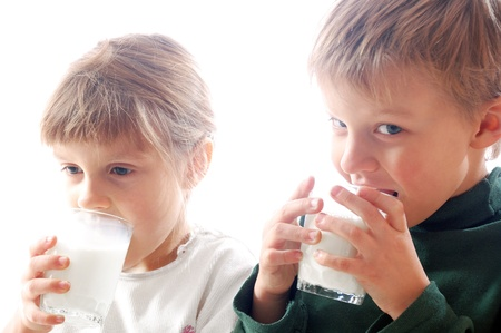 glass of milk: kids drinking milk from glasses together
