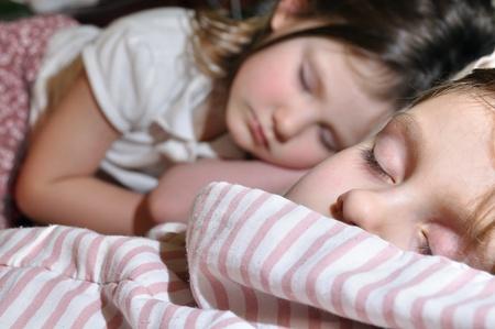 'eyes shut: two girls sleeping Stock Photo
