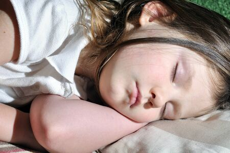 little girl sleeping at home Stock Photo